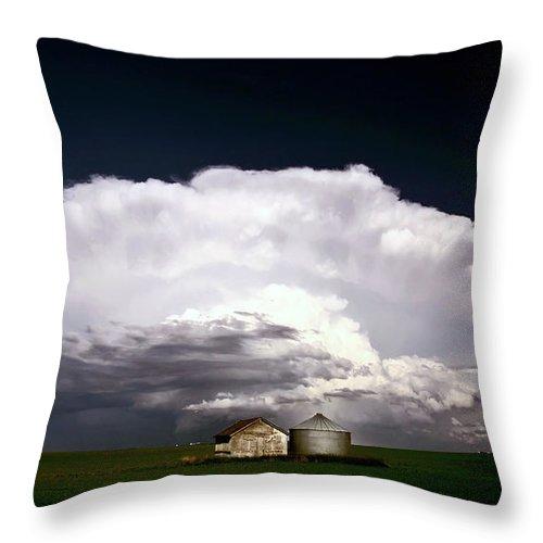 Cumulonimbus Throw Pillow featuring the digital art Storm Clouds Over Saskatchewan Granaries by Mark Duffy
