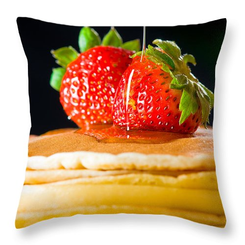 Berries Throw Pillow featuring the photograph Strawberry Butter Pancake With Honey Maple Sirup Flowing Down by U Schade