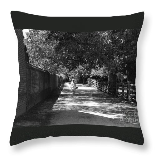 Colonial Throw Pillow featuring the photograph Stroll To Store by Eric Liller