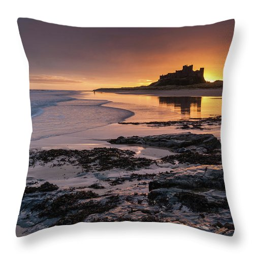 Sunrise Throw Pillow featuring the photograph Sunrise at Bamburgh Castle #4, Northumberland, North East England by Anthony Lawlor