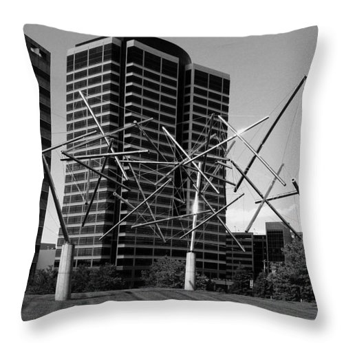 Metal Throw Pillow featuring the photograph Suspended by Angus Hooper Iii