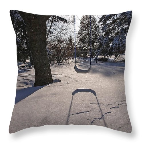 Swings Throw Pillow featuring the photograph Swing Shadow On Snow by Steve Somerville