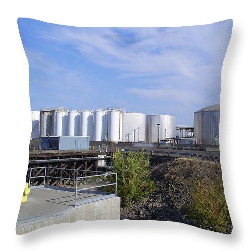 Nustar Throw Pillow featuring the photograph Tank Farm Nustar by Alan Espasandin