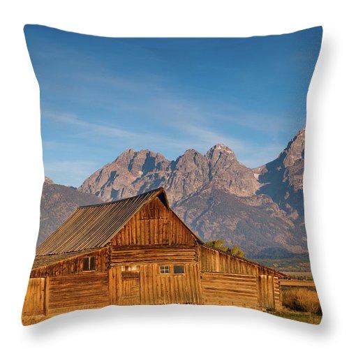 Grand Teton Throw Pillow featuring the photograph Teton Barn by Steve Stuller