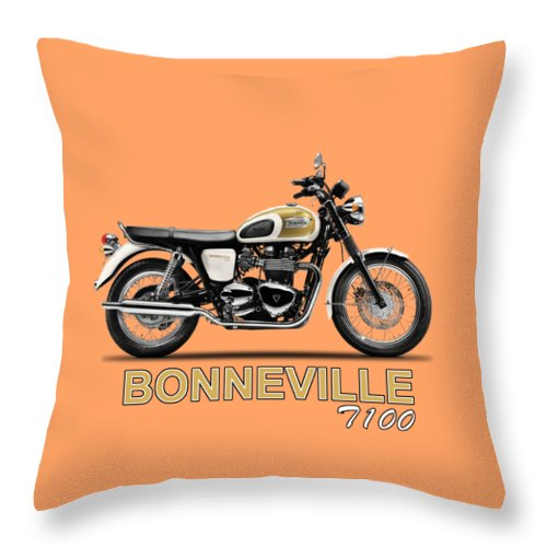 Triumph Bonneville T100 Throw Pillow featuring the photograph The Bonneville T100 by Mark Rogan