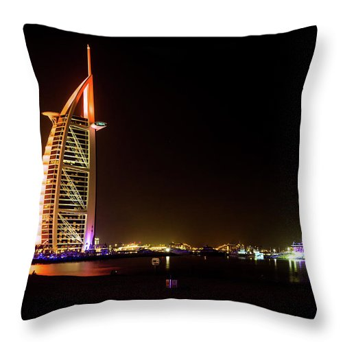Hotel Throw Pillow featuring the photograph The Burj Al Arab At Night by Andrew Matwijec