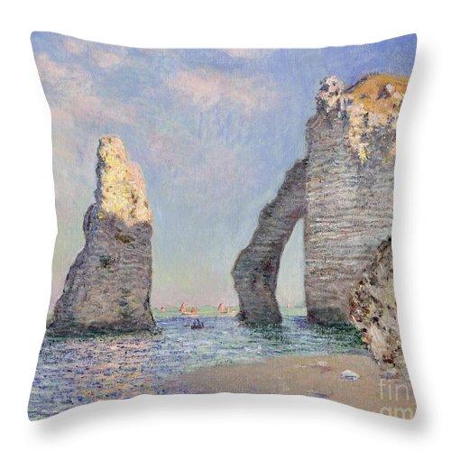 The Cliffs At Etretat Throw Pillow featuring the painting The Cliffs at Etretat by Claude Monet