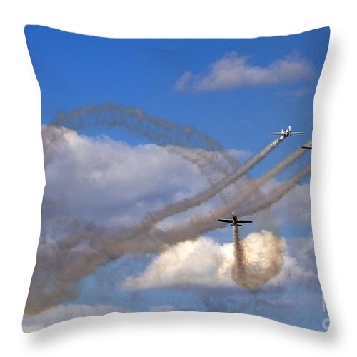 Aerostars Yak-50 Display Team Throw Pillow featuring the photograph The Corkscrew by Angel Ciesniarska