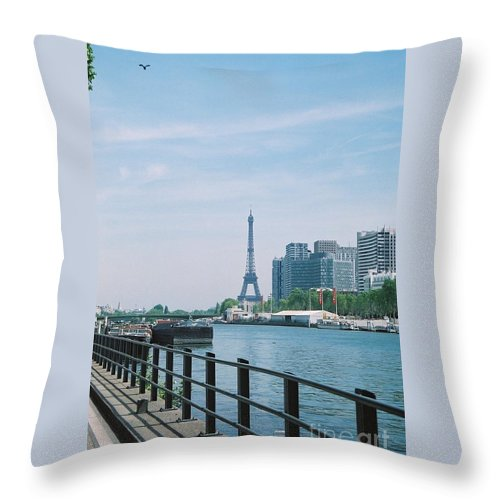 The Eiffel Tower Throw Pillow featuring the photograph The Eiffel Tower And The Seine River by Nadine Rippelmeyer