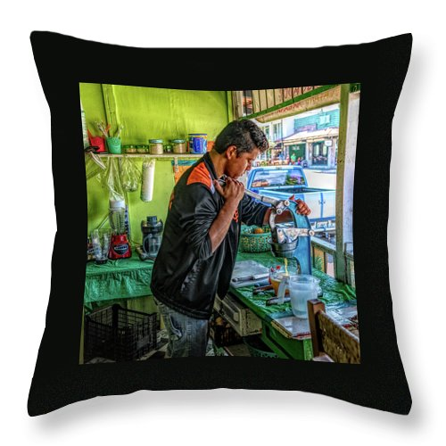 Jalisco Throw Pillow featuring the photograph The Juice Man by Paul LeSage
