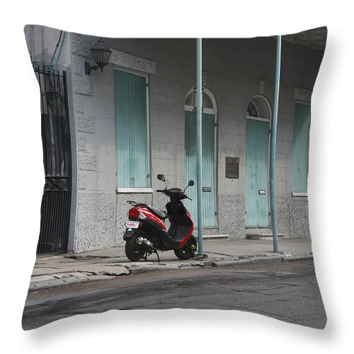 French Quarters Throw Pillow featuring the photograph The Lone Bike by JoAnn Grafton