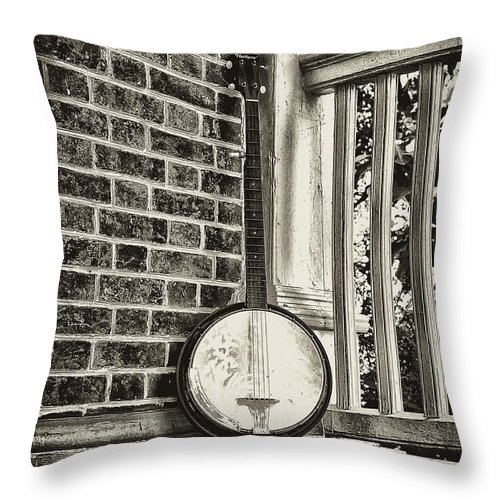Banjo Throw Pillow featuring the photograph The Lonely Banjo by Bill Cannon