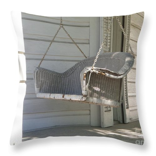 Porch Throw Pillow featuring the photograph The Old Porch Swing. by Ann Davis