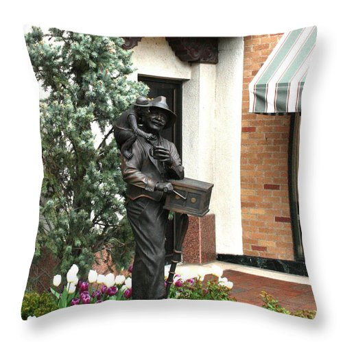 Statue Throw Pillow featuring the photograph The Organ Grinder Kansas City Missouri by David Dunham