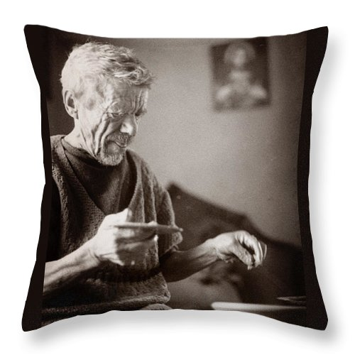 Ukraine Throw Pillow featuring the photograph The Potter Of Haweryvschyna by Yuri Lev
