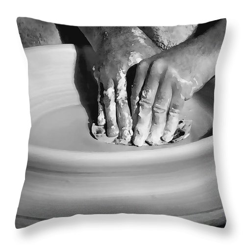 Hand Throw Pillow featuring the photograph The Potter by Sharon Foster
