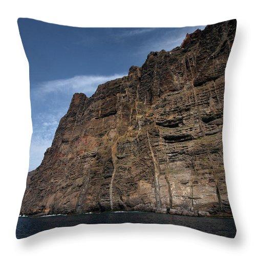 Valasretki Throw Pillow featuring the photograph The Rocks Of Los Gigantes 1 by Jouko Lehto