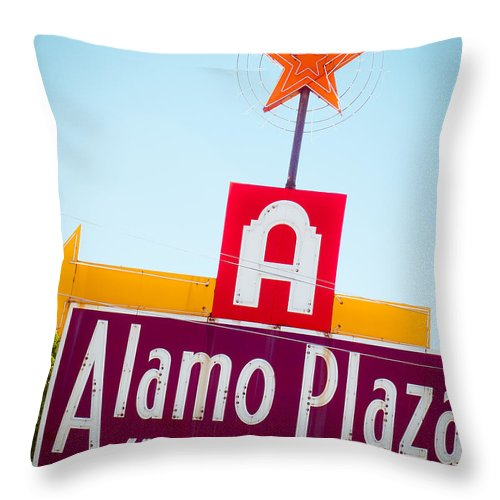 Neon Sign Throw Pillow featuring the photograph The Star Of Alamo Plaza by Sonja Quintero