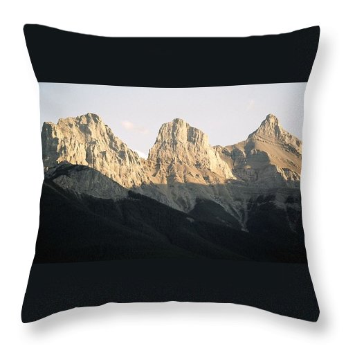 Rocky Mountains Throw Pillow featuring the photograph The Three Sisters Of The Rockies by Tiffany Vest