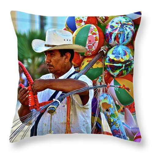Toys Throw Pillow featuring the photograph The Toy Man by Diana Hatcher