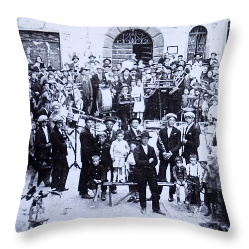 Tuscany Throw Pillow featuring the photograph The Village Band by Kurt Hausmann