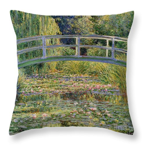 The Throw Pillow featuring the painting The Waterlily Pond with the Japanese Bridge by Claude Monet
