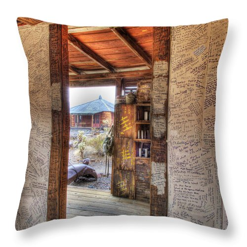 Ghost Town Throw Pillow featuring the photograph The Writing's On The Wall by David Wagner