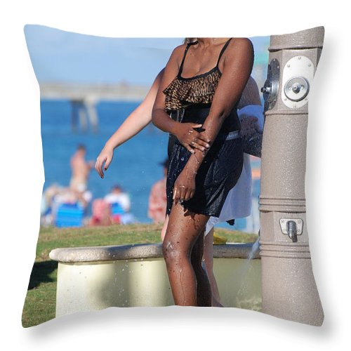 Bathing Suit Throw Pillow featuring the photograph Three Arms At The Shower by Rob Hans