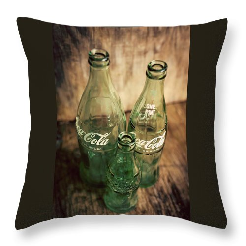 Terry D Photography Throw Pillow featuring the photograph Three Vintage Coca Cola Bottles by Terry DeLuco