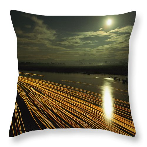 Asia Throw Pillow featuring the photograph Time Lapse Of Lights From Boats Moving by Steve Winter