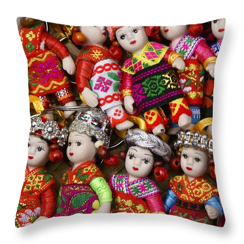 Asia Throw Pillow featuring the photograph Tiny Chinese Dolls by Michele Burgess