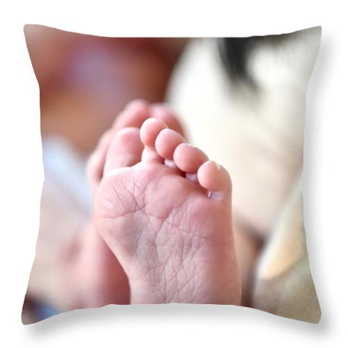 Babies Feet Throw Pillow featuring the photograph Tiny Feet by Jeramey Lende