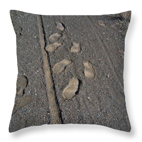 Prescott Throw Pillow featuring the photograph Tire Tracks And Foot Prints by Heather Kirk