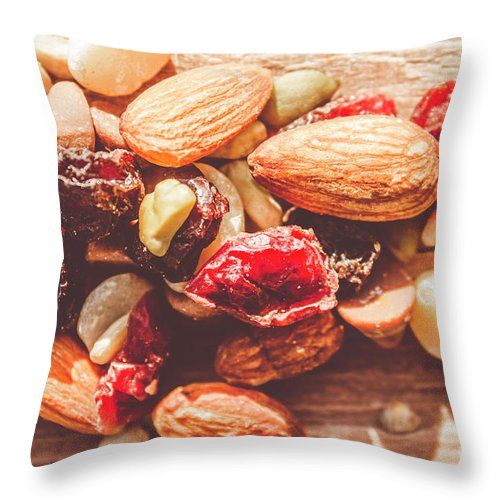 Almond Throw Pillow featuring the photograph Trail Mix High-energy Snack Food Background by Jorgo Photography - Wall Art Gallery