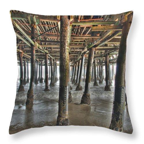 Under The Boardwalk Throw Pillow featuring the photograph Under The Boardwalk Pier Sunbeams by David Zanzinger