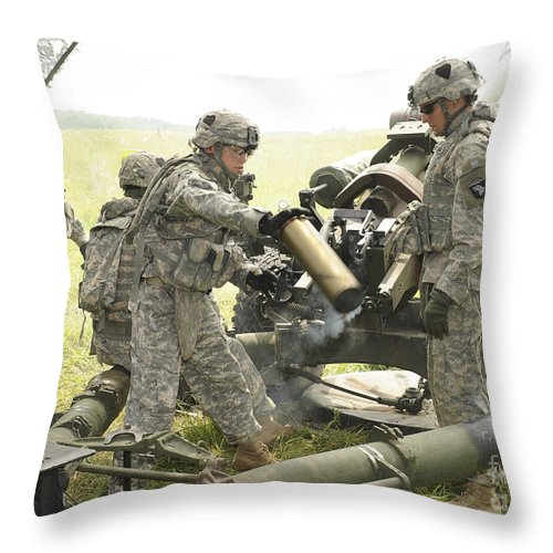 Military Throw Pillow featuring the photograph U.s. Army Soldier Throws A Spent 105mm by Stocktrek Images