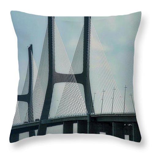 Vasco Da Gama Bridge Throw Pillow featuring the photograph Vasco da Gama Bridge in Lisbon by Kirsten Giving