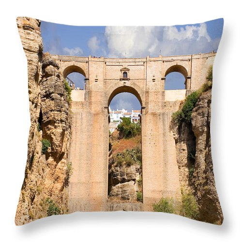 Ronda Throw Pillow featuring the photograph View Of The Tajo De Ronda And The Puente Nuevo Bridge From Across The Valley by Mal Bray