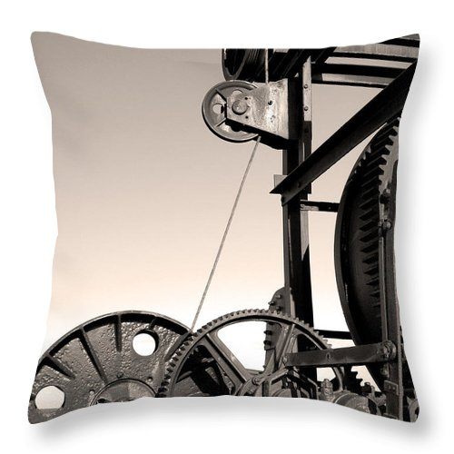 Antique Throw Pillow featuring the photograph Vintage Machinery by Gaspar Avila