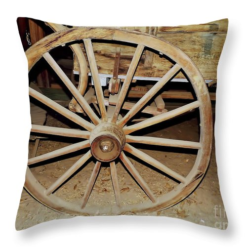 Wheel Throw Pillow featuring the photograph Wagon Wheel by D Hackett