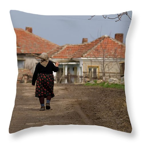 Walking Home After A Days Work In The Fields Throw Pillow featuring the photograph Walking Home by Cliff Norton
