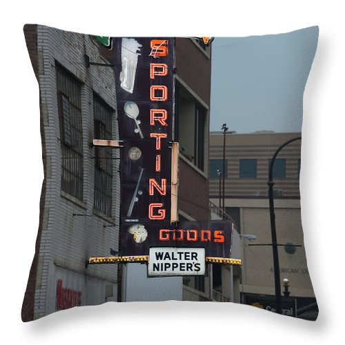 Sporting Throw Pillow featuring the photograph Walter Nippers Sporting Goods by Grant Groberg