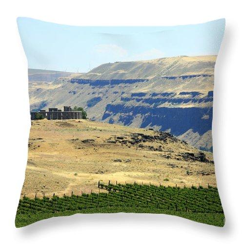 Washington State Throw Pillow featuring the photograph Washington Stonehenge With Vineyard by Carol Groenen