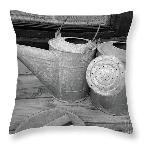 Watering Cans Throw Pillow featuring the photograph Watering Cans And Tubs B W by D Hackett