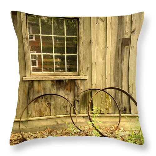 Wheel Rims Throw Pillow featuring the photograph Wheel Rims by Ian MacDonald