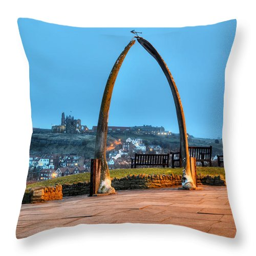 Whitby Whalebone Throw Pillow featuring the photograph Whitby Whalebone Blue Hour by Sarah Couzens