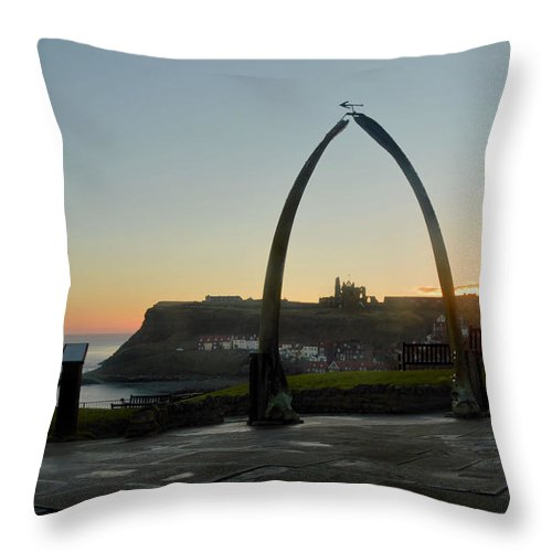 Whitby Whalebone Throw Pillow featuring the photograph Whitby Whalebone Golden Hour by Sarah Couzens