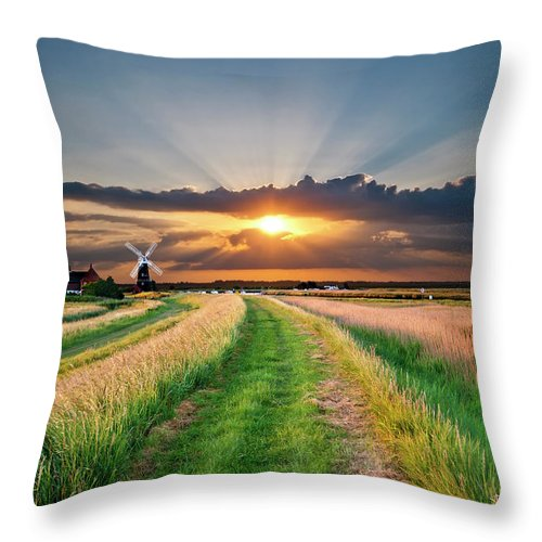 Windmill Throw Pillow featuring the photograph Windmill At Sunset by Meirion Matthias