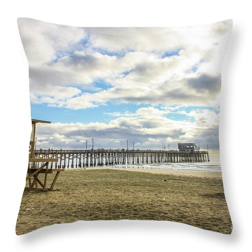 Balboa Pier Throw Pillow featuring the photograph Winters Beach by Tommy Anderson