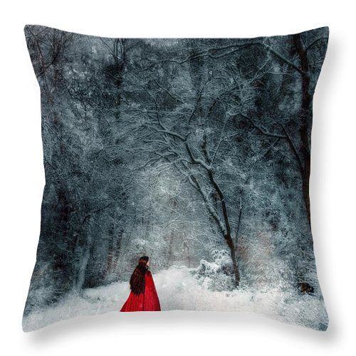 Walking Throw Pillow featuring the photograph Woman In Red Cape Walking In Snowy Woods by Jill Battaglia